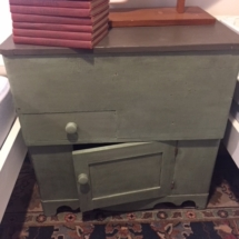 Primitive painted cabinet with lifting top