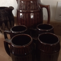Antique stoneware pitcher and mugs