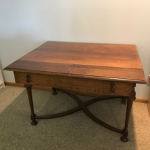 Beautiful, antique oak table with unique leaf extension in drawer.