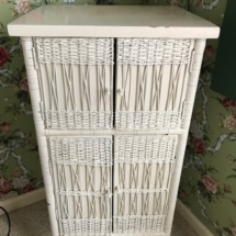 Antique white wicker cabinet