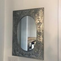 Stamped tin mirror