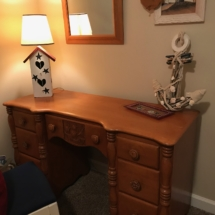 Unique desk with ship carving on drawer