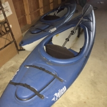 Two Pelican kayaks with paddles