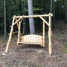 $300 Rustic swing with cushions. Handcrafted in Northern Michigan