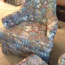 Pair of floral upholstered chairs with ottoman