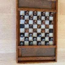 Antique folk art checker board with Djaya pieces