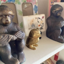 Vintage brass owl from Canada and monkey bookends from India
